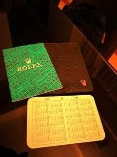 Rolex 1990 / 1991 Translation booklet, calendar card and green wallet holder.