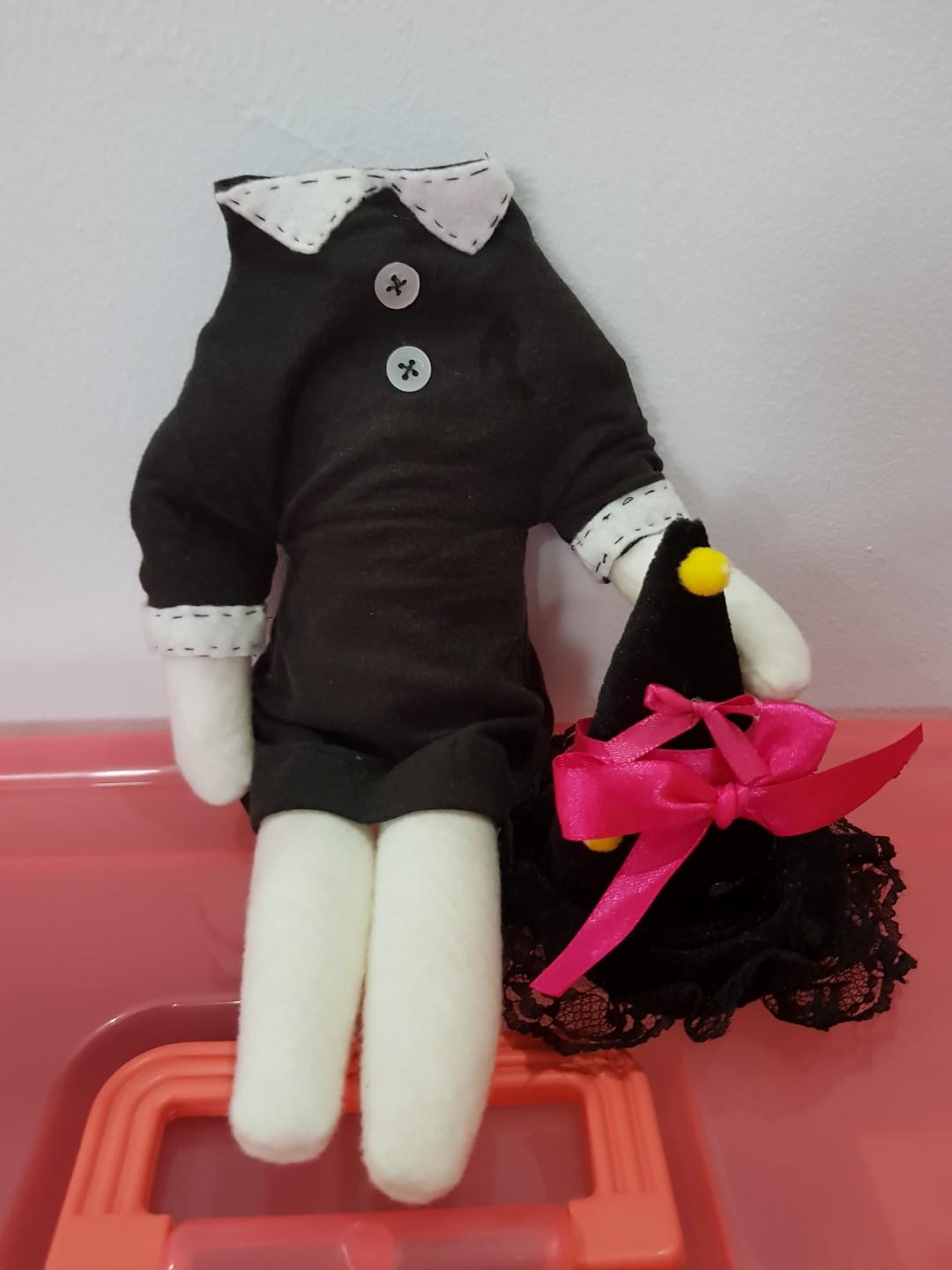 Wednesday Addams' headless doll