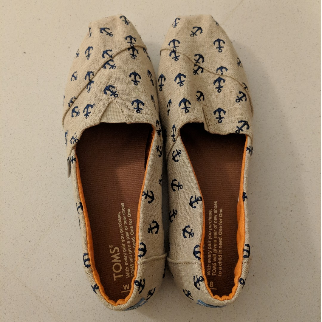 8cef01235e7 Women s Toms shoes size 8! Beige   Tan colour with orange trimming ...