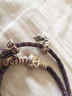 Purple pandora bracelet with 2 charms