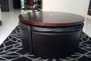 Designer round table with 4 hidden storage stools