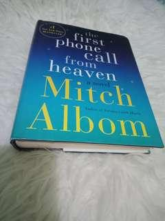 Micth albom,  the first phone call from heaven.  Hardcover