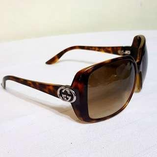 Original GUCCI Sunglasses with Metallic GUCCI Logo on both cornerd. Good condition. No box. $78