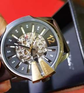 """DIESEL Automatic Watch, unused. DZ1730 111509. """"Bravely out of time"""" engraved behind.  See-thru glass on both sides to show of great mechanism. Unused, Good working.  $128 offer. WhatsApp 96337309."""