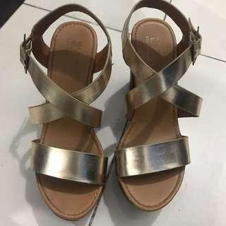 People are People gold platform heels
