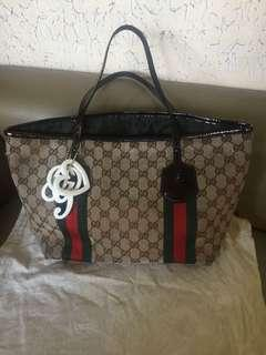 Authentic gucci tote with charms