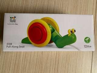 Plan toys pull along snail toy