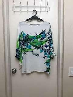 L Criselda Lontok White Poncho Blouse with Flower Print