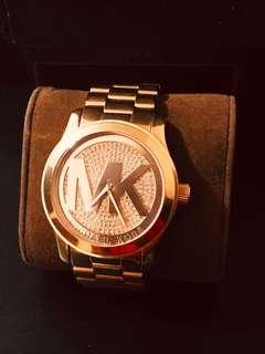 Round rose gold michael kors analog watch with link bracelet