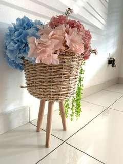 Wooden basket with flowers