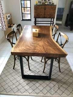 Suar wood dining table with powder coated metal legs
