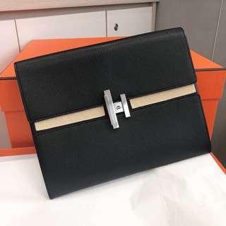 "Hermes Cinhetic clutch, medium model Size: 7.2"" long, 6.7"" high and 3.3"" deep"