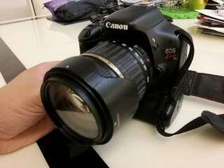 Canon 550D with 18mm - 200mm lens + 4 batteries & battery pack + TTL flash. Perfect condition