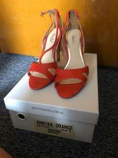 Wanted orange heels size 8