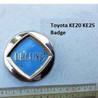 "Toyota KE20 KE25 ""Deluxe"" badge"