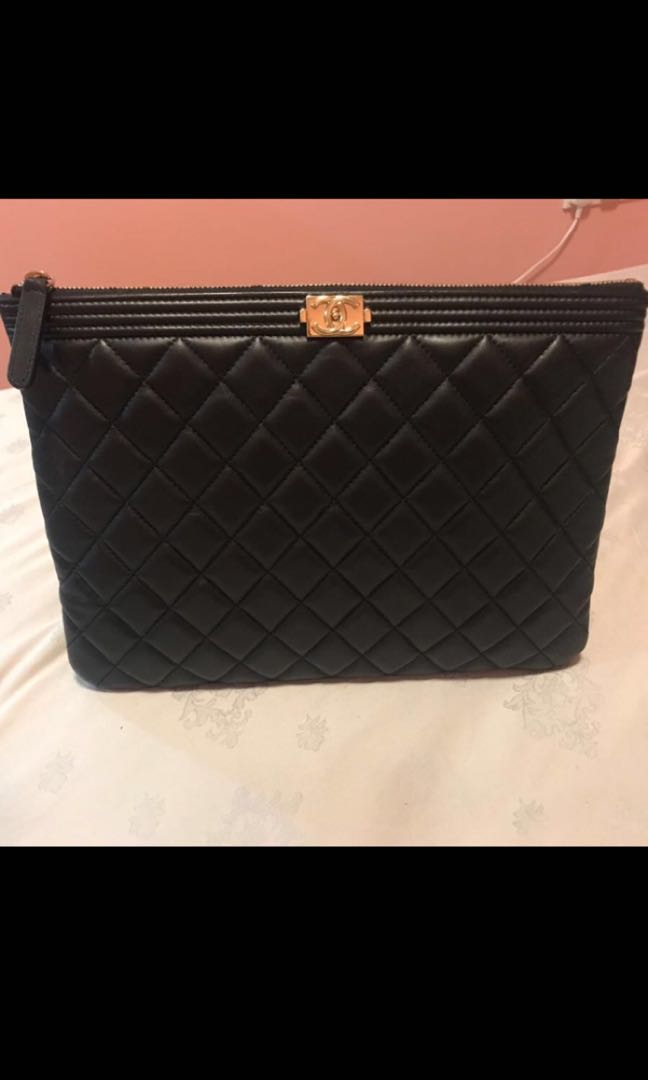 bdf60ef9a32c Chanel Boy Clutch medium, Luxury, Bags & Wallets, Handbags on Carousell