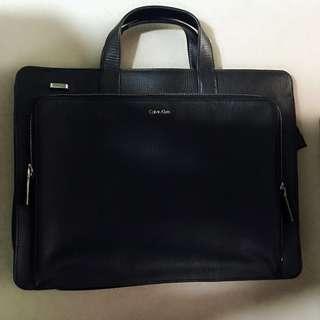 black leather Calvin Klein briefcase laptop bag