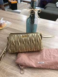 Miu Miu matelasse gold clutches