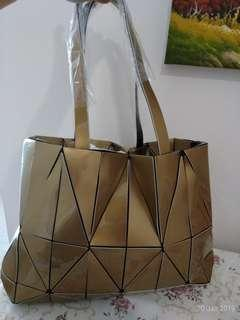 Gold coloured hand bag