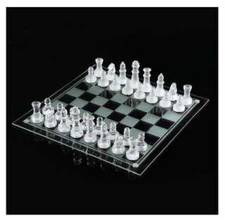 Glass chess set with extra set of pieces