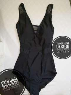 Black Swimsuit with Transparent Fabric