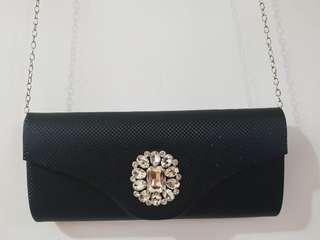 Black bejewelled sling clutch bag