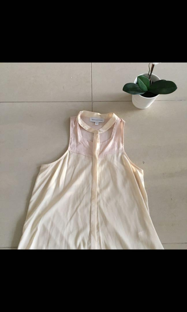 Finders Keepers cream sleeveless top with neck cutout detail
