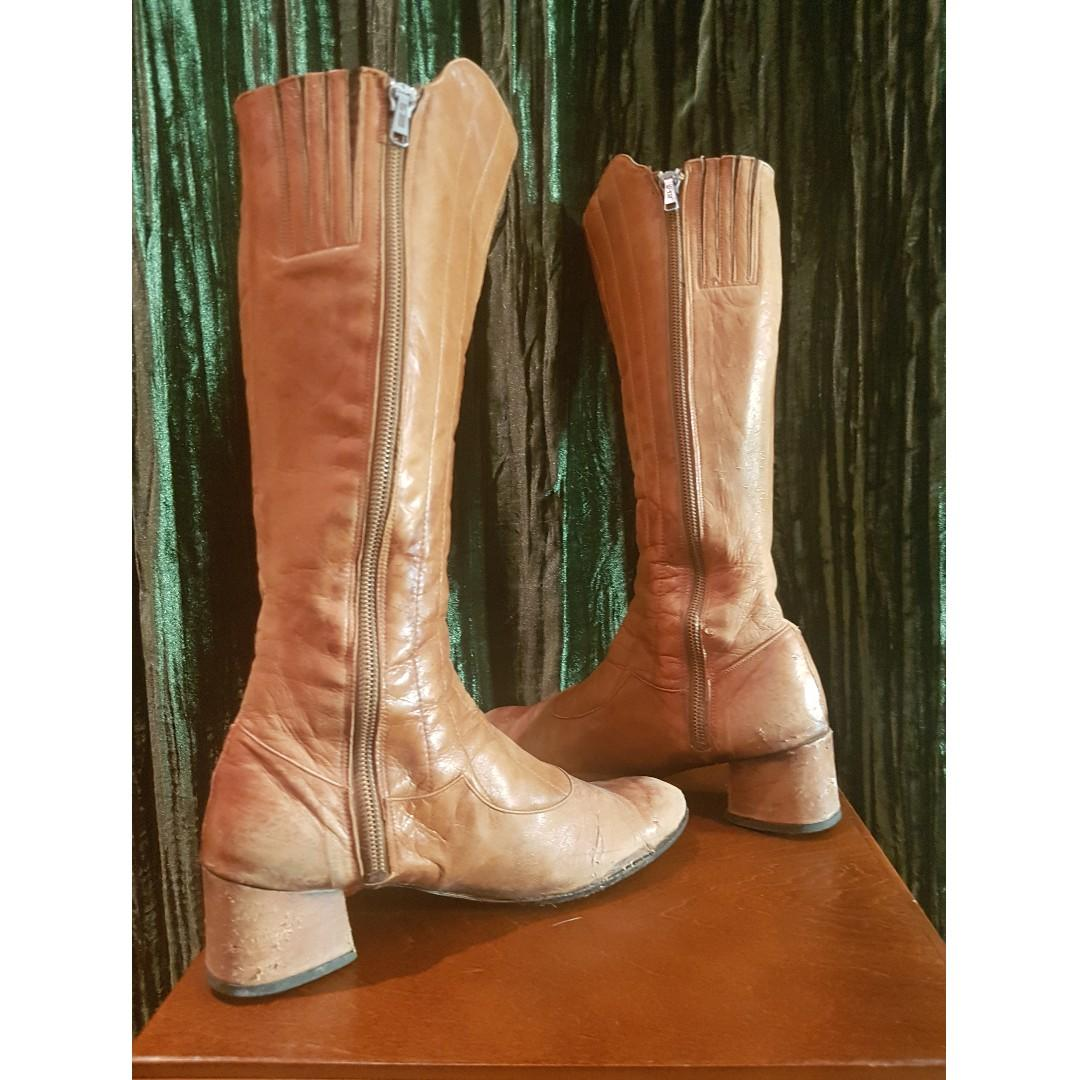 Well loved tan, mid-calf boots with mule heel. Made in Spain, fits like an 8 or 8.5