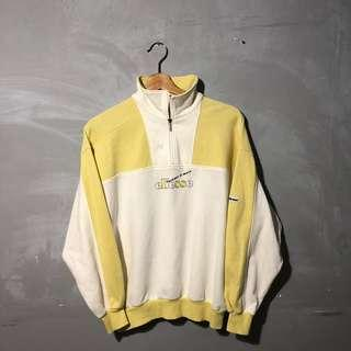 VINTAGE WOMANS ELLESSE YELLOW HALF ZIP