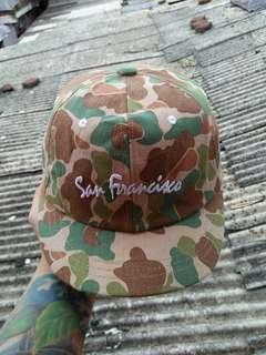 Topi U.S ARMY/Russian military hats Brand: San Fransisco Full tag logo brand Full motif camo/army Military Logo brand full bordir Size: free/all size(pakai strap belakang)  Unisex(bisa untuk cowok/cewek) Kondisi 97% sangat mulus seperti baru