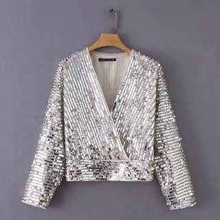 Disko locate wrap sequin adorned blouse