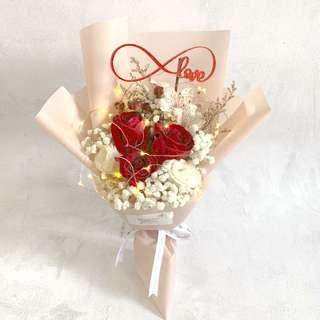 3 red roses with eustomas and baby breath