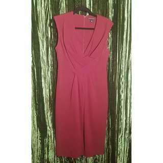 Take this dress to work and then out for the night!  Banana Republic, maroon sheath dress size 10.