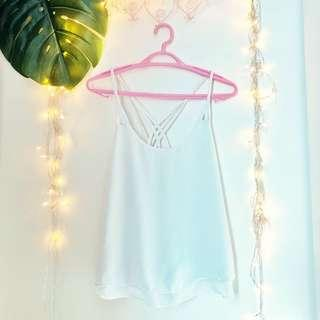 White top with braided straps and back details