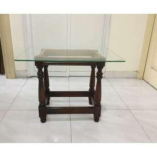 Glass top wooden legs side table