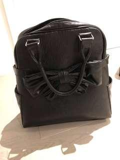 Rolling leather laptop bag