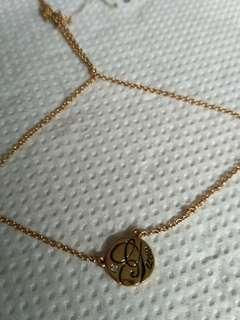 Guess coin pendant necklace gold