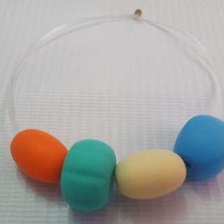 Sensory oral motor chewy bracelet orange,turquoise,cream & blue