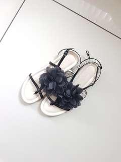 Black sandals with black flower
