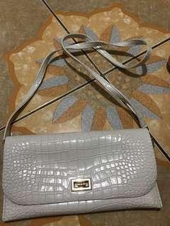 Snake skin sling bag