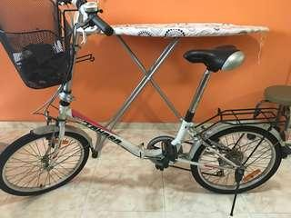 Foldable bicycle with adjustable gear