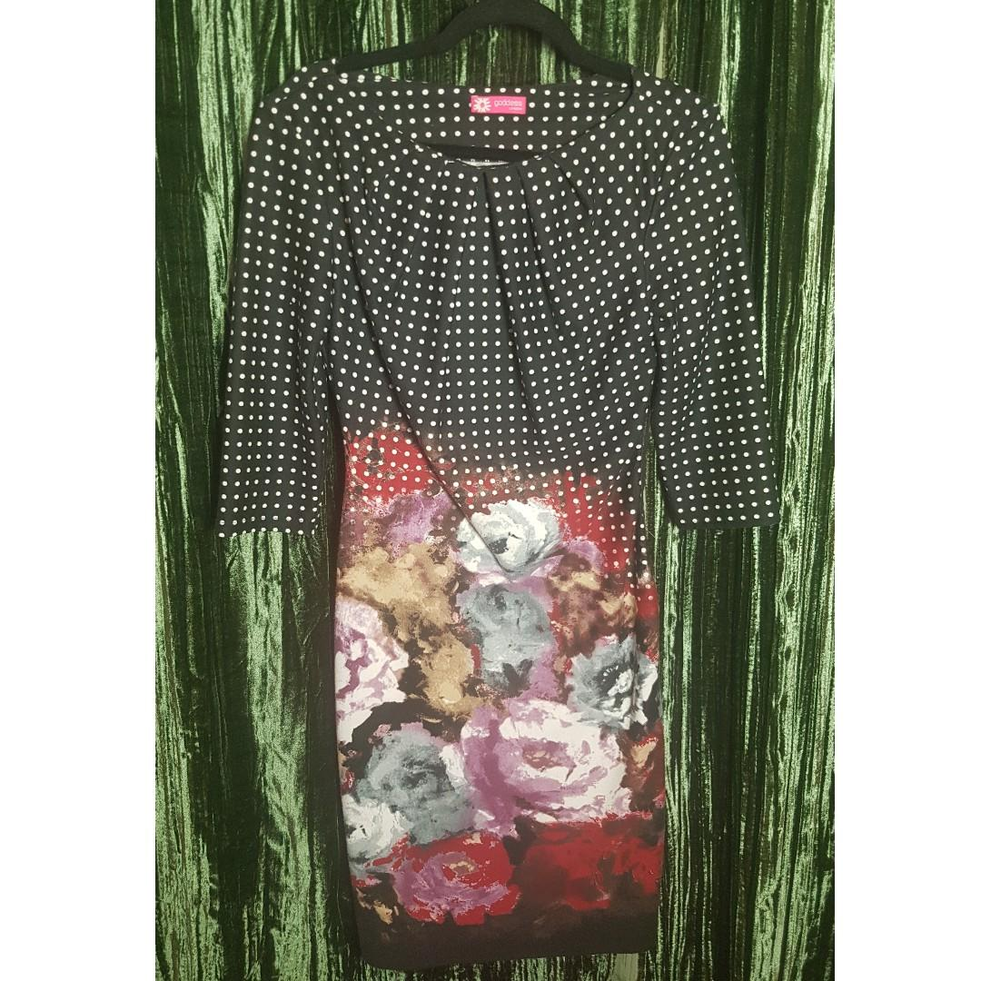 Fun floral dress to wear year round! Sheath style, size 10