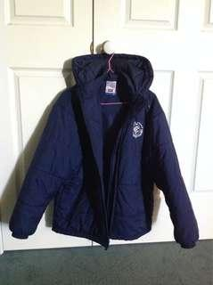 Nike winter jacket. Keeps warm. Carlton emblem. Used once. Very good condition . $40.