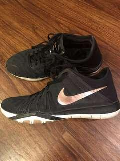 Nike rose gold sign sneakers