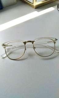 Gold rim glasses transparent glass