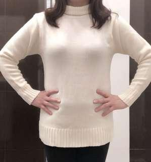 Broken white turtle neck sweater
