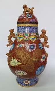 Maroon antique porcelain vase with eagles motives
