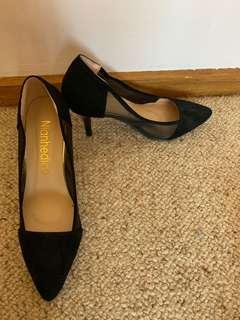 Black heels with a mesh on the side