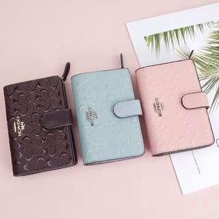 Coach medium embossed wallet