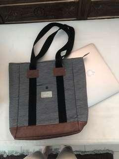 Cool striped fabric bag with compartment for 13in computer.  Looks great on you or as a present to someone you like! Multipurpose bag.